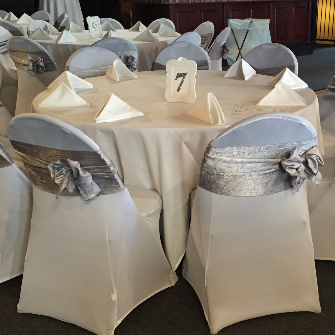 ivory chair covers spandex pottery barn kitchen table and chairs sitting pretty folding cover