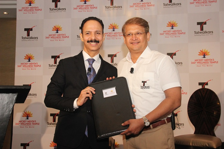 (From L to R) Holistic health guru, Dr. Mickey Mehta signed the agreement with Mr. Prashant Talwalkar, MD & CEO of Talwalkars Better Value Fitness Limited. Image source: Supplied