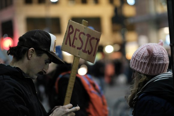 resist-wlp-man-and-woman-and-sign
