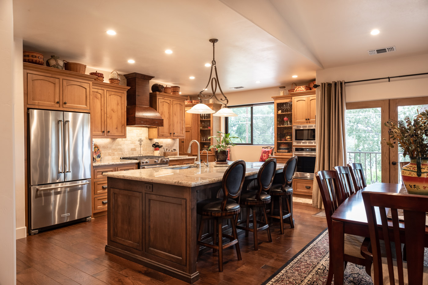 custom kitchen cabinetry copper faucet tuscan artisan and bathroom cabinets in atascadero stained alder wood