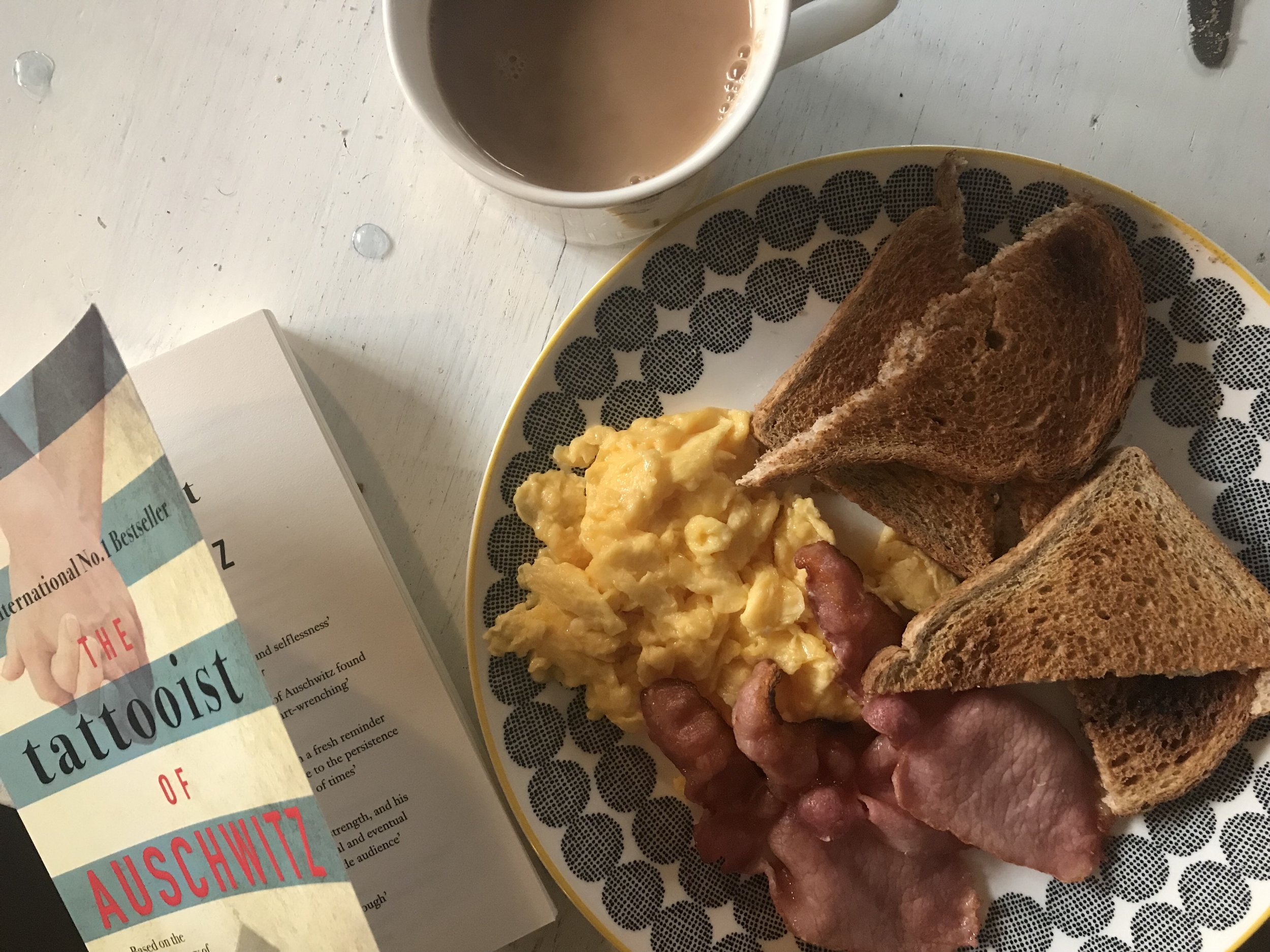 A book, breakfast and tea.