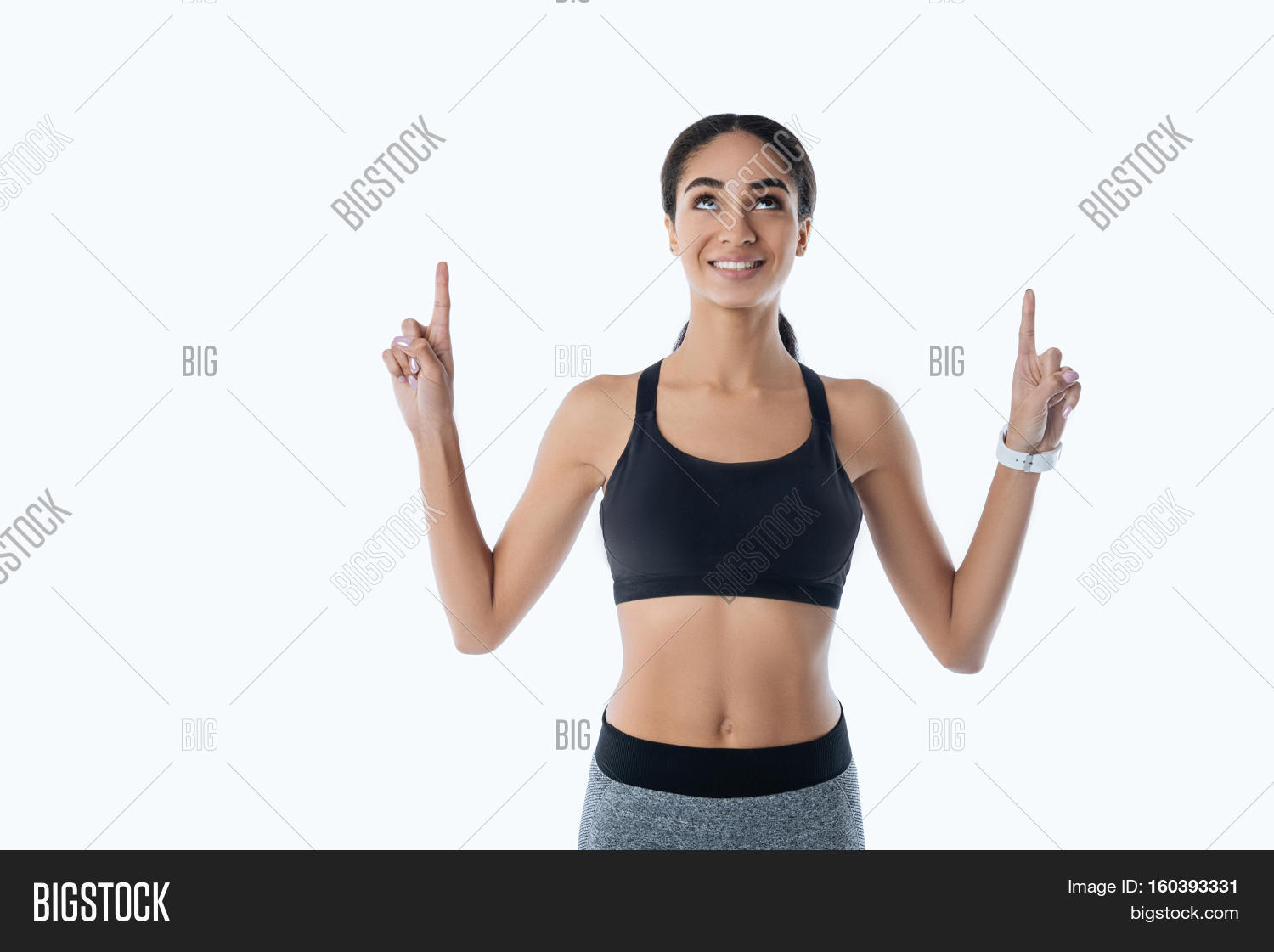 hight resolution of healthy sporty girl holding arms bent in elbow pointing upwards