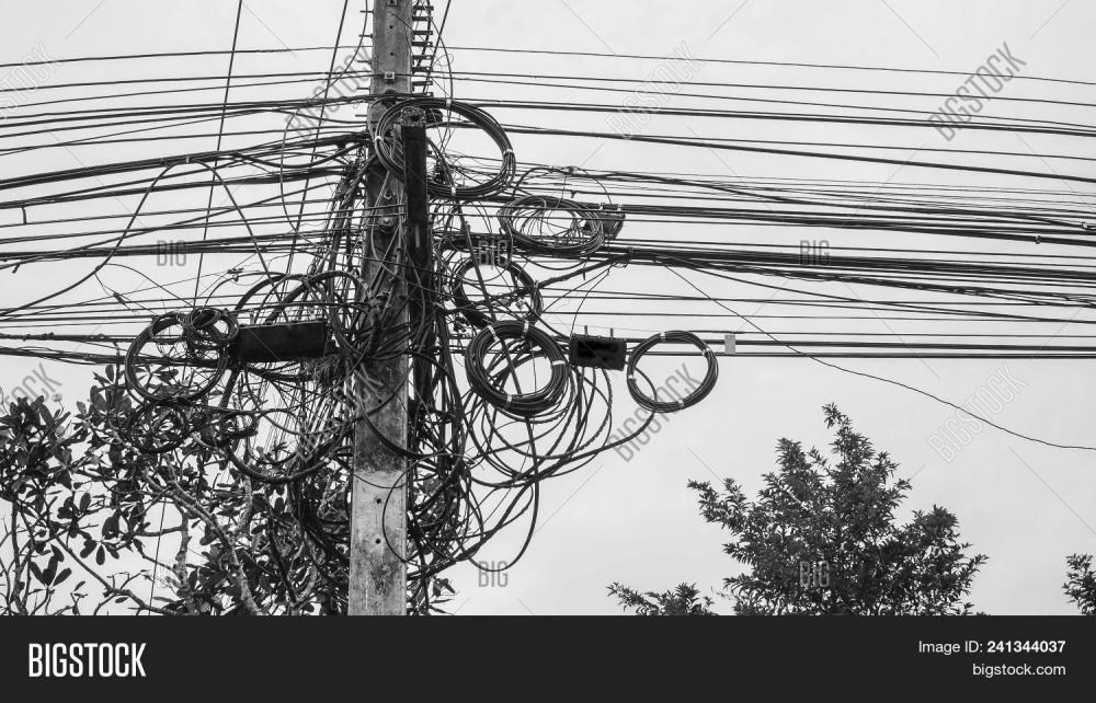 medium resolution of potential danger from a mess of wires at thailand electric pole with electric wire tangled very messy electricity or telephone pole