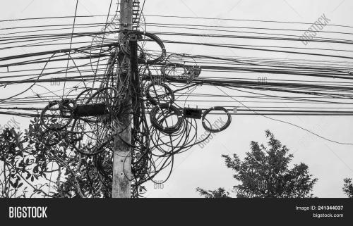 small resolution of potential danger from a mess of wires at thailand electric pole with electric wire tangled very messy electricity or telephone pole