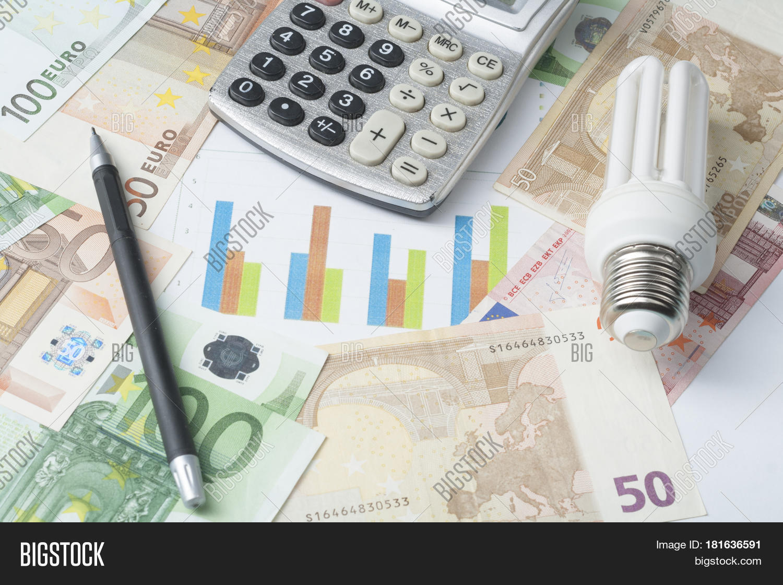 hight resolution of energy saving lamp chart and calculator on money background eco energy saving light bulb
