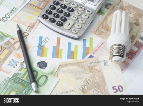 small resolution of energy saving lamp chart and calculator on money background eco energy saving light bulb