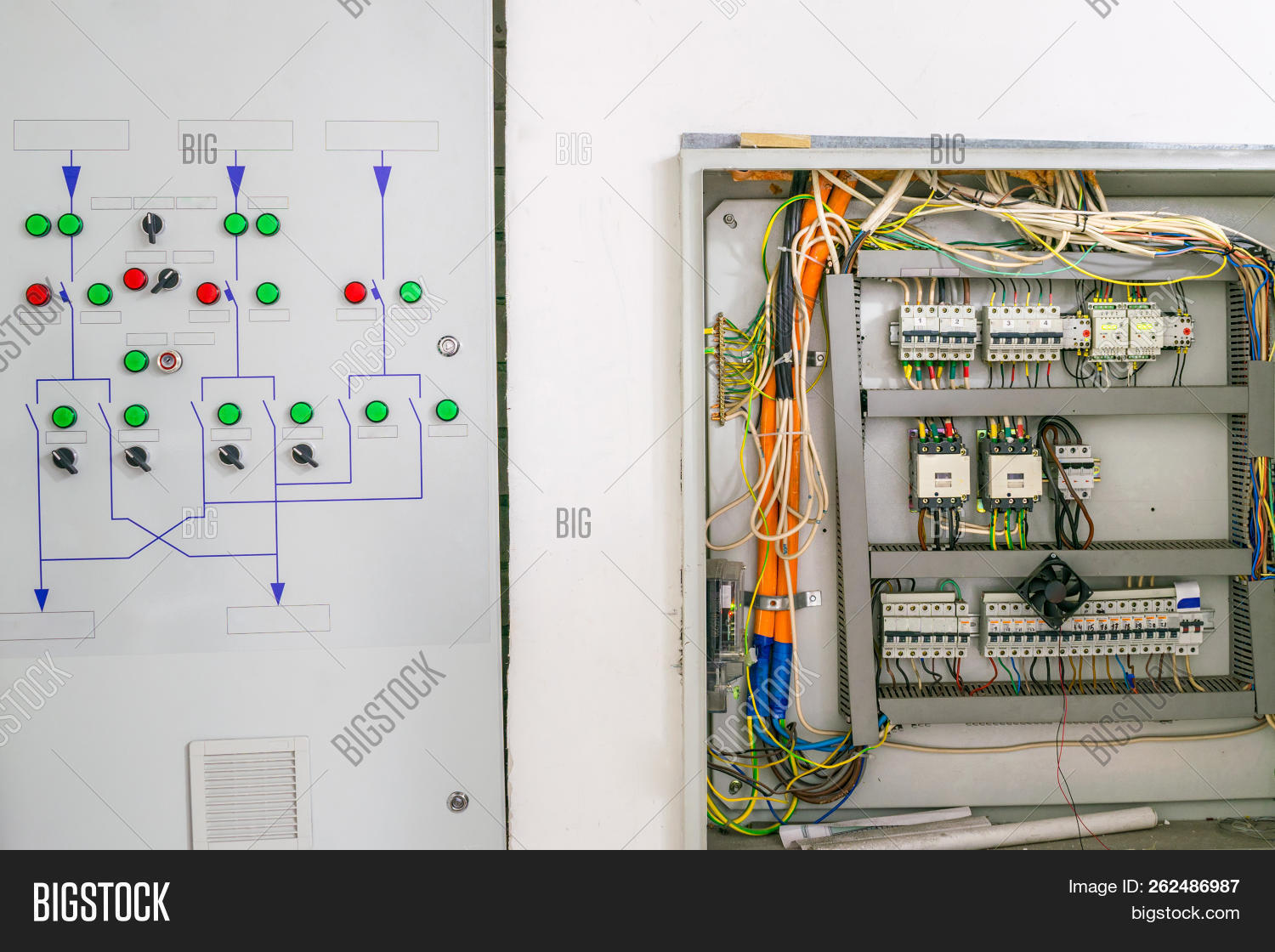 hight resolution of an electrical box containing many contacts relays switches and wires technical cabinet with high voltage equipment and powerful power cables