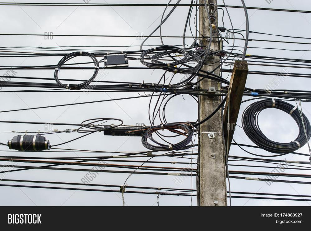 medium resolution of high voltage power pole with wires tangled wire and cable clutter potential danger from