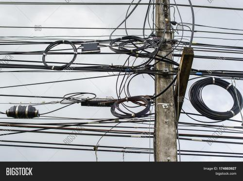 small resolution of high voltage power pole with wires tangled wire and cable clutter potential danger from