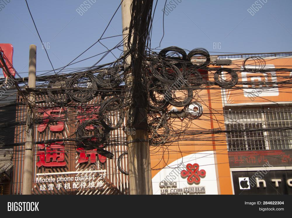 medium resolution of messy tangle of electric and telephone wires on street pole shanghai china december