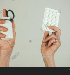 pills medications hands old female hands hold pills in blister pack and pill bottle packaging [ 1500 x 1120 Pixel ]