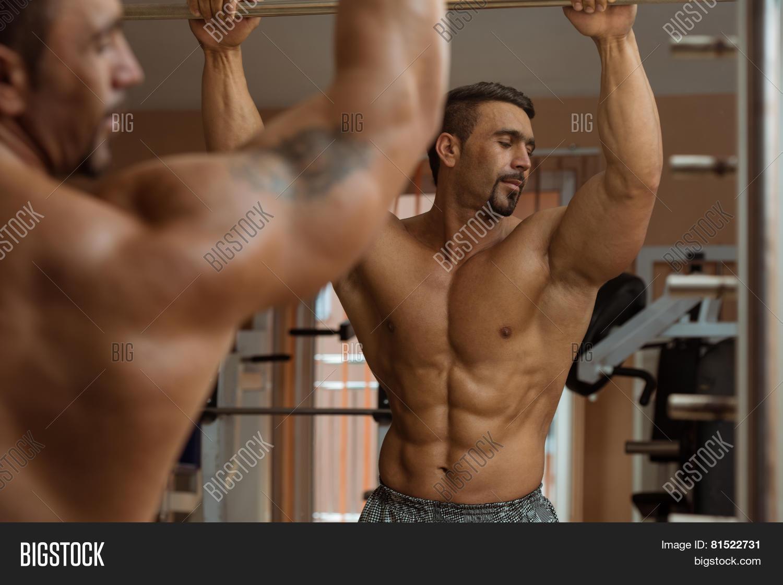 muscular men flexing image