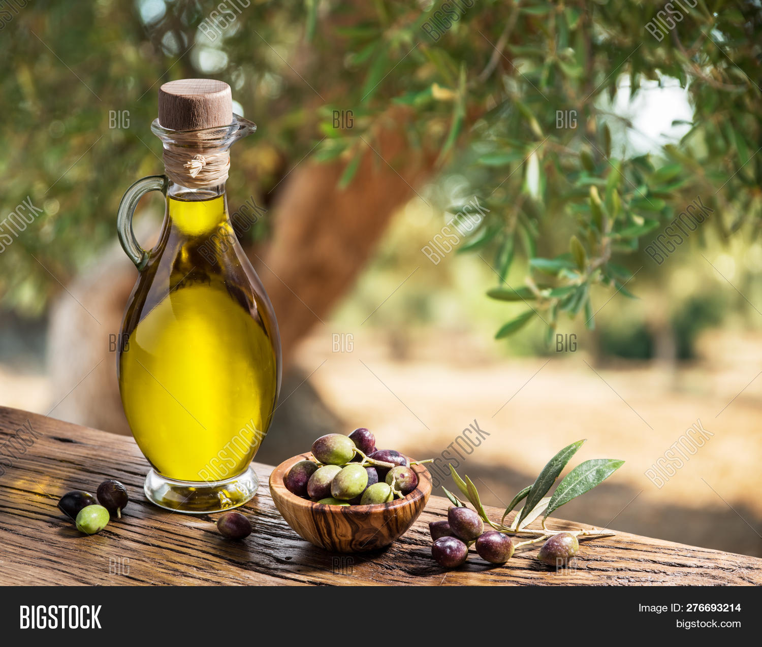 Olive Oil On Wooden Table