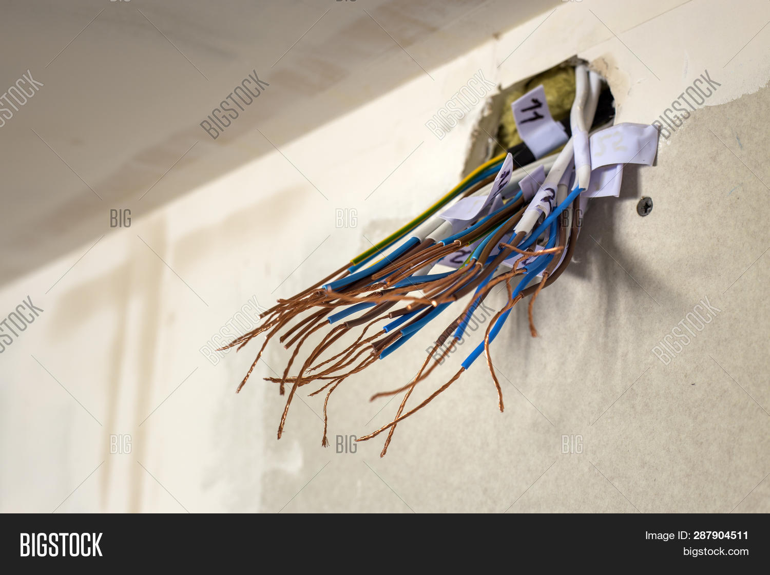 hight resolution of electrical exposed connected wires protruding from socket on white wall electrical wiring installat