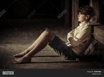 Barefoot Boy Imprisoned Straight & Bigstock