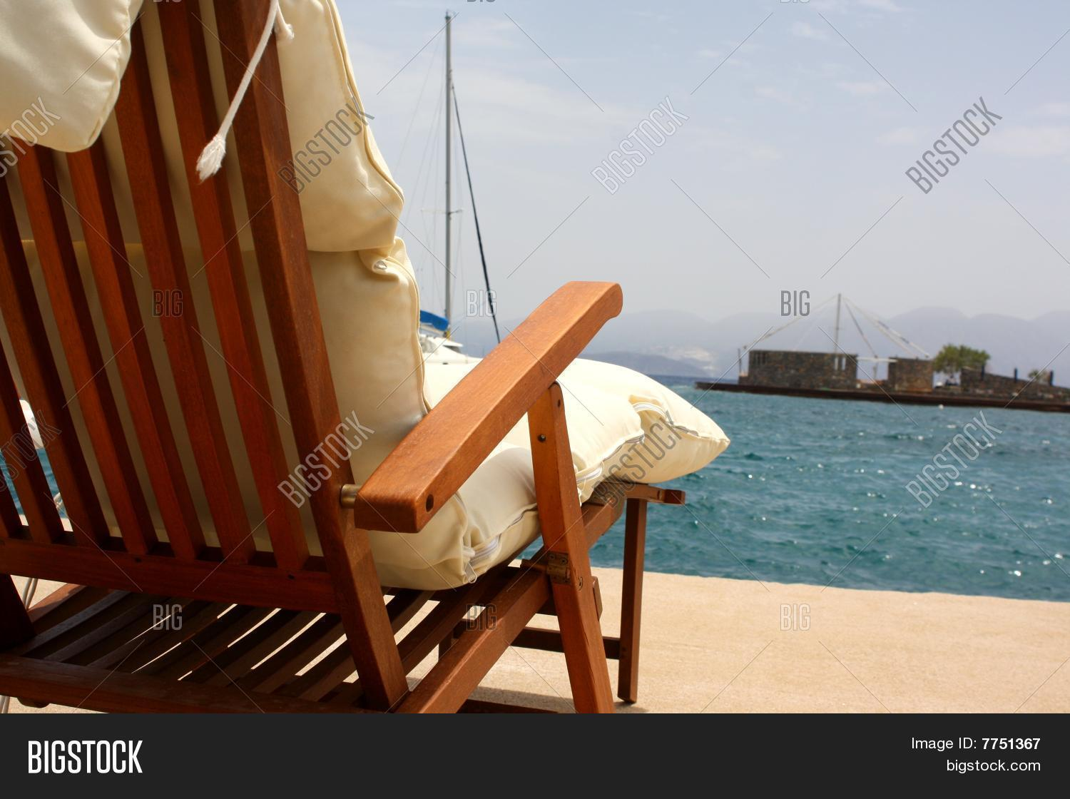 lay down beach chairs reclining leather massage chair image and photo bigstock