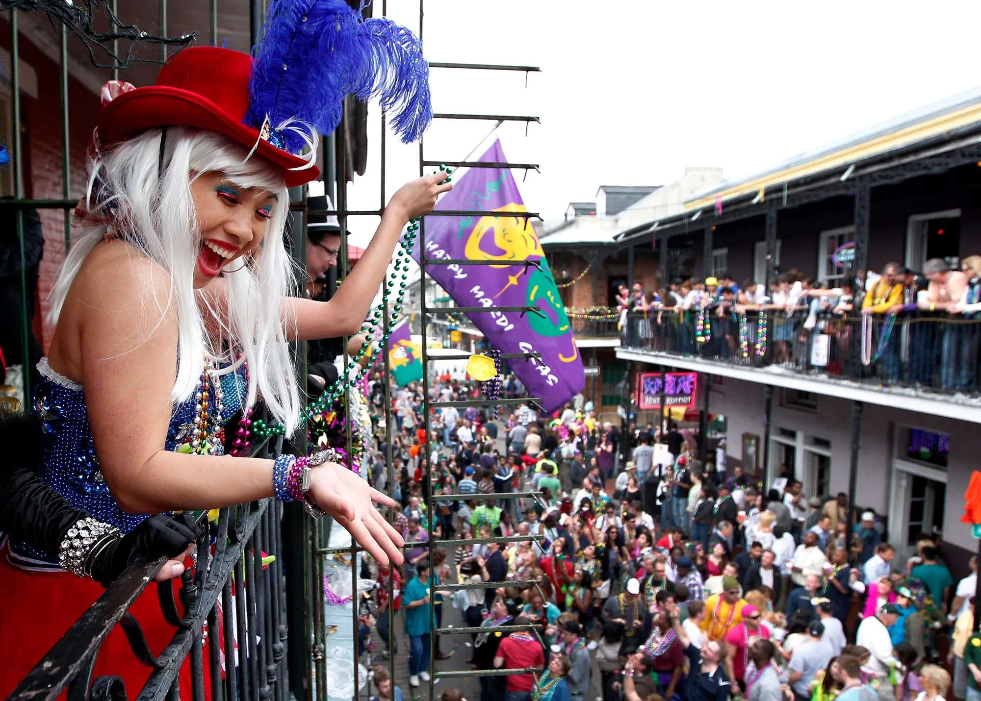 Catch some colored beads at a Mardi Gras parade in New Orleans, Louisiana.