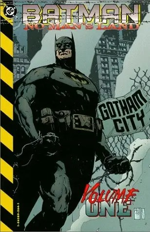 "September 1999: ""No Man's Land"" comic – Batman returns with the gold emblem around the bat logo and a grey and blue suit, a mix between the Troika and Year One costumes."