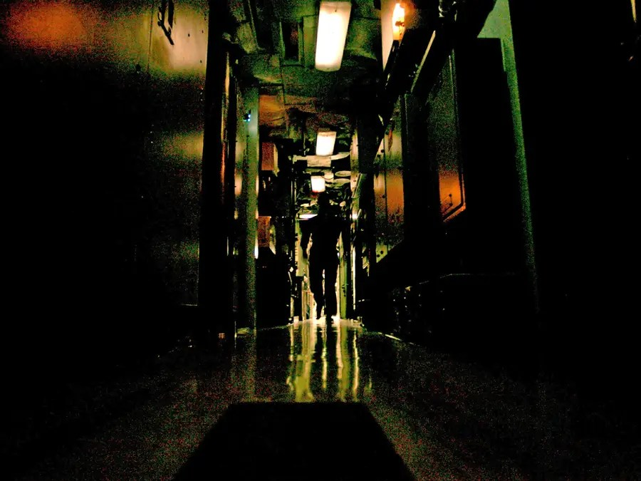 This hallway — extending from the engine room, over the reactor and through the living habitat in the center of the ship — is dark so that sailors can sleep