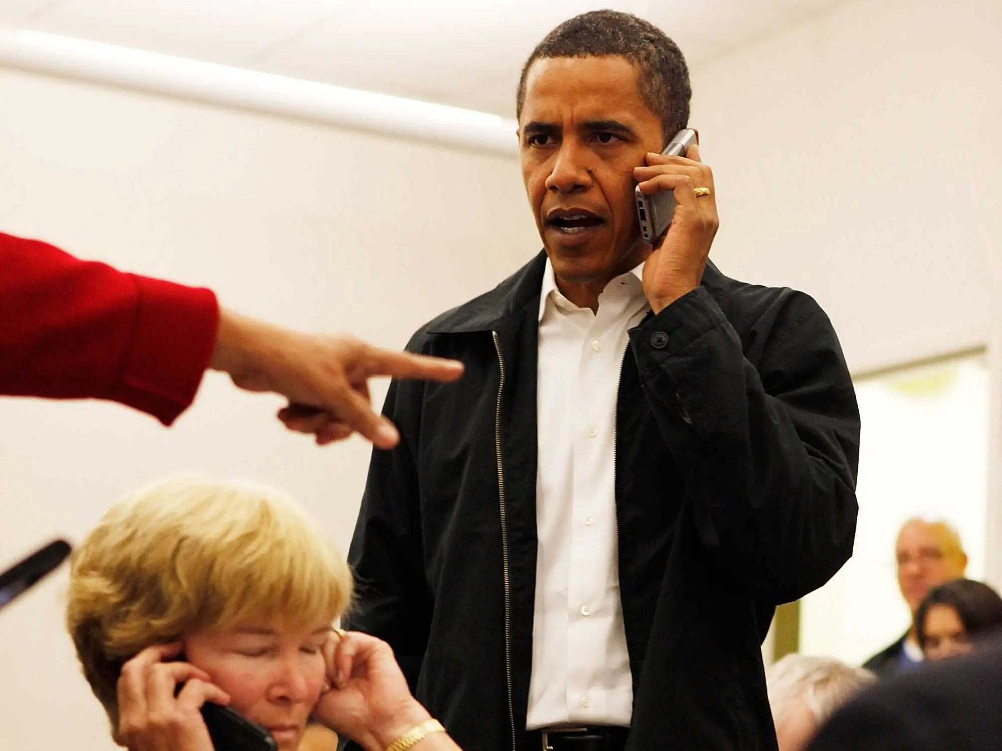 Nov. 3, 2008: Obama talks on his BlackBerry in Charlotte, NC on the eve of election day.
