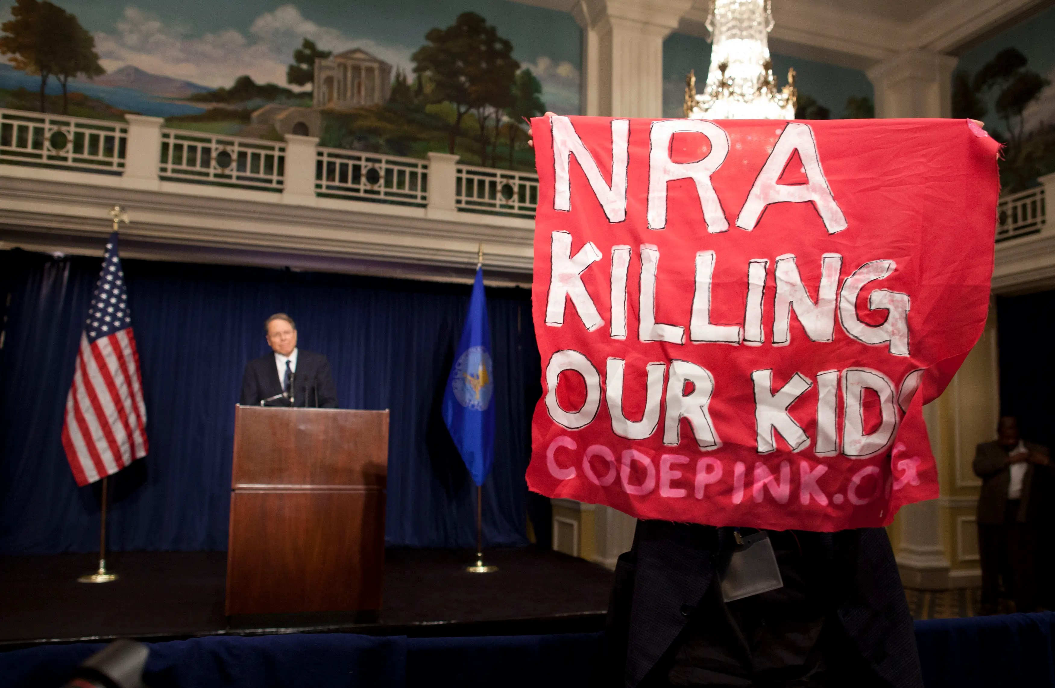 Protester at NRA Press Conference, Protester, Gun control