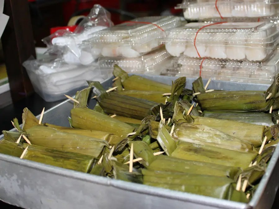 Otak-otak is a cake made of mashed fish that's mixed with coconut milk, chili, and spices, wrapped in a banana leaf, and grilled over charcoal. It's a traditional Peranakan (a local Singaporean ethnic group) dish.
