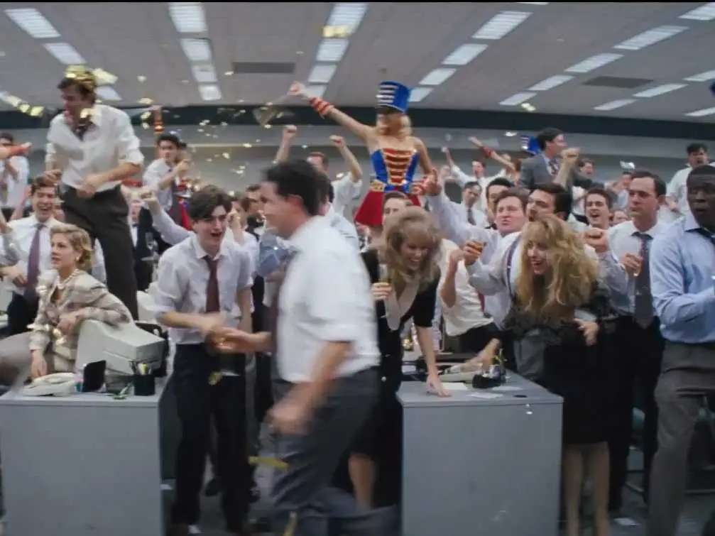 Stratton-Oakmont grows to over 100 employees and makes $28.7 million in penny stocks. Jordan basically has a ticker tape parade in the office.