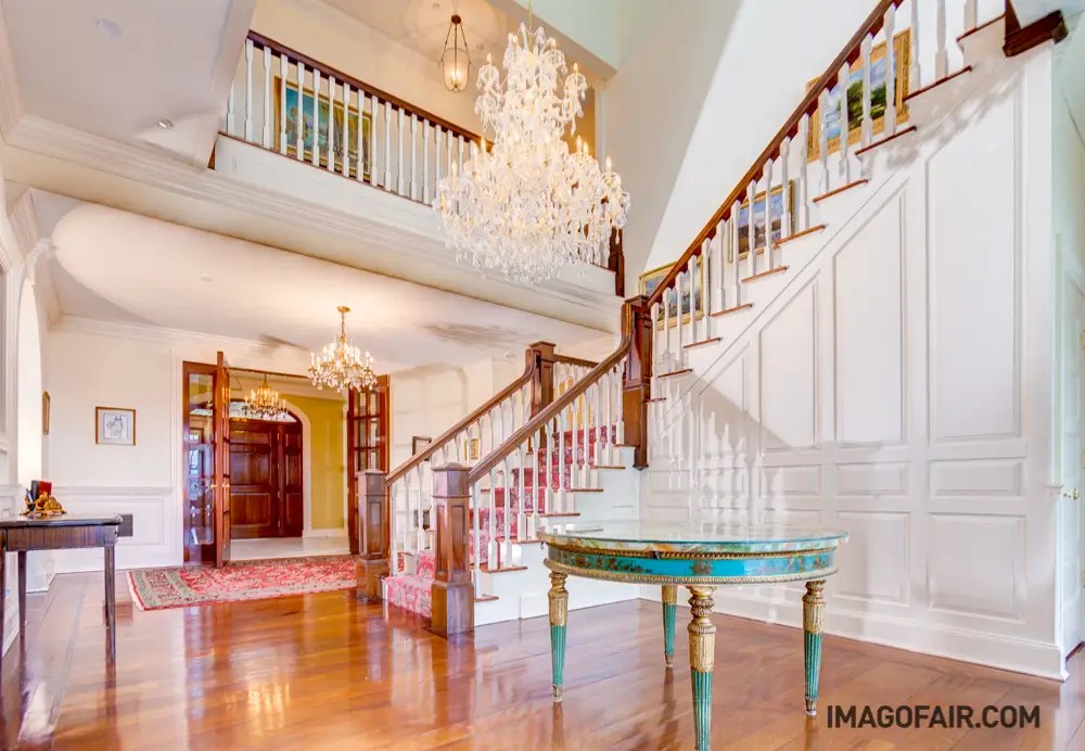 The main staircase adds to the drama and splendor of the entranceway.