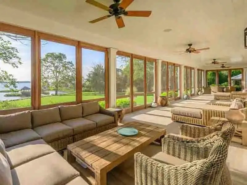 You can relax in the vast sunroom which looks out toward the water.
