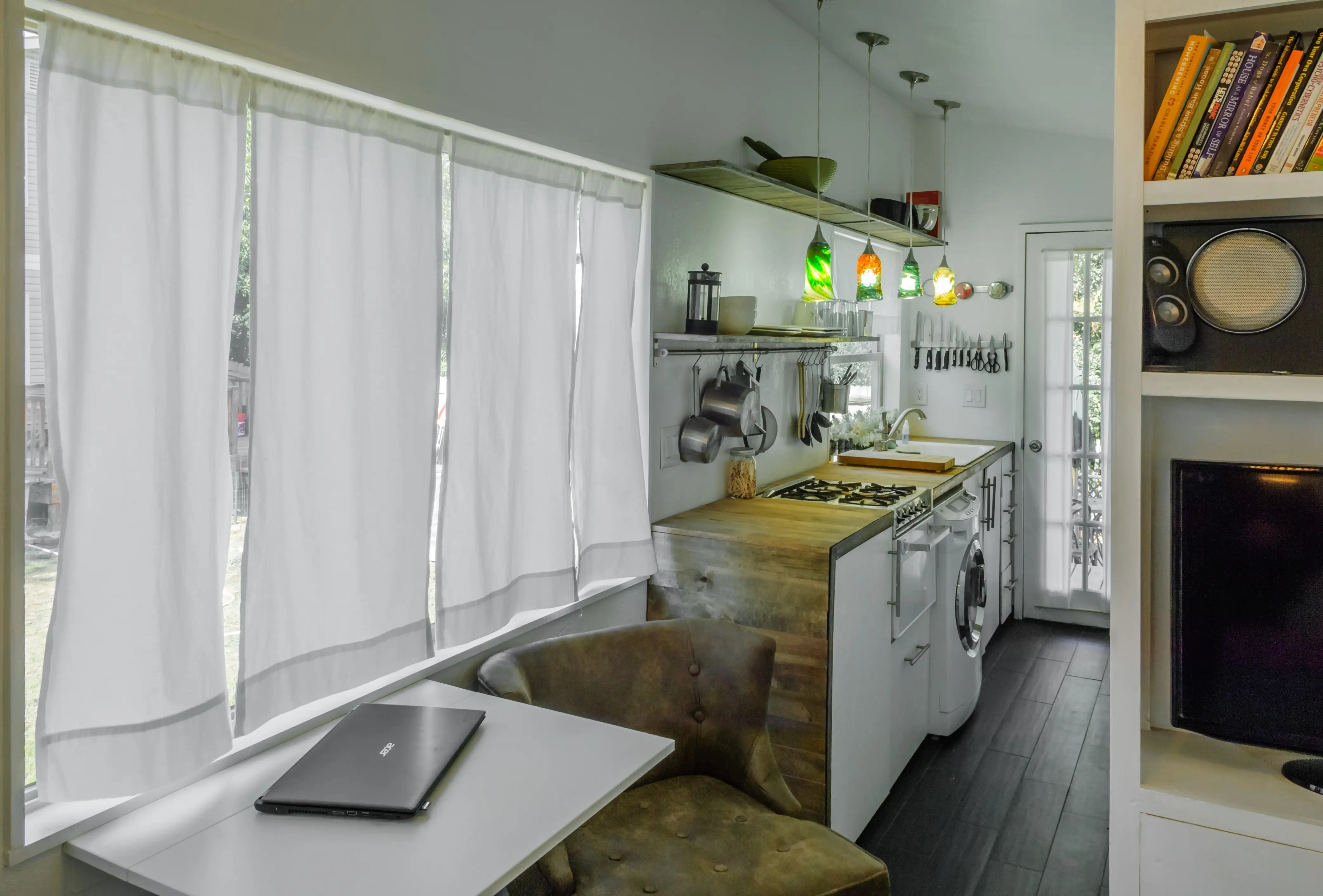 Underneath the kitchen counters, she has a two-in-one washer/dryer.