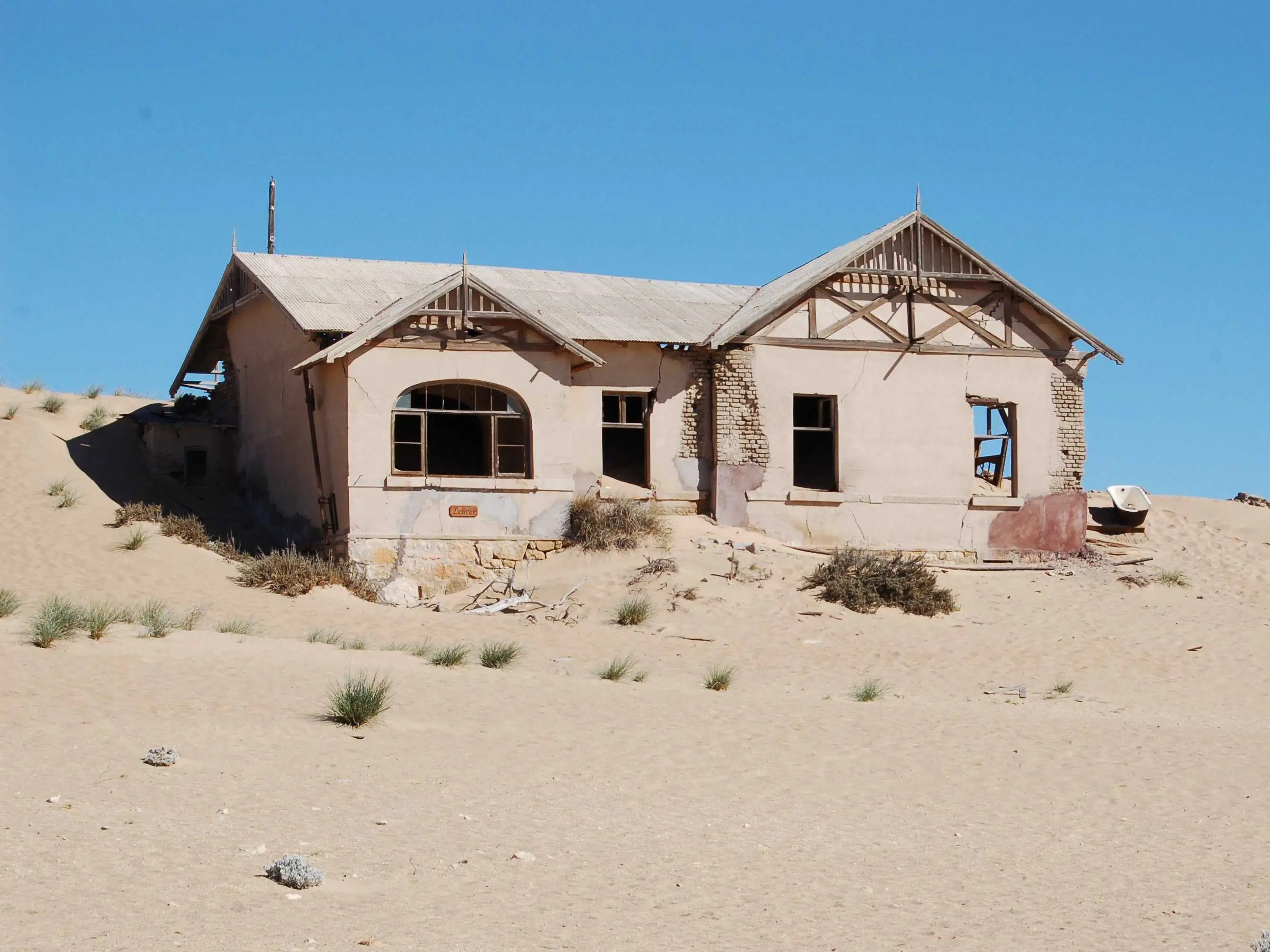 Visit the mining town of Kolmanskop, Namibia, before it is buried in sand.