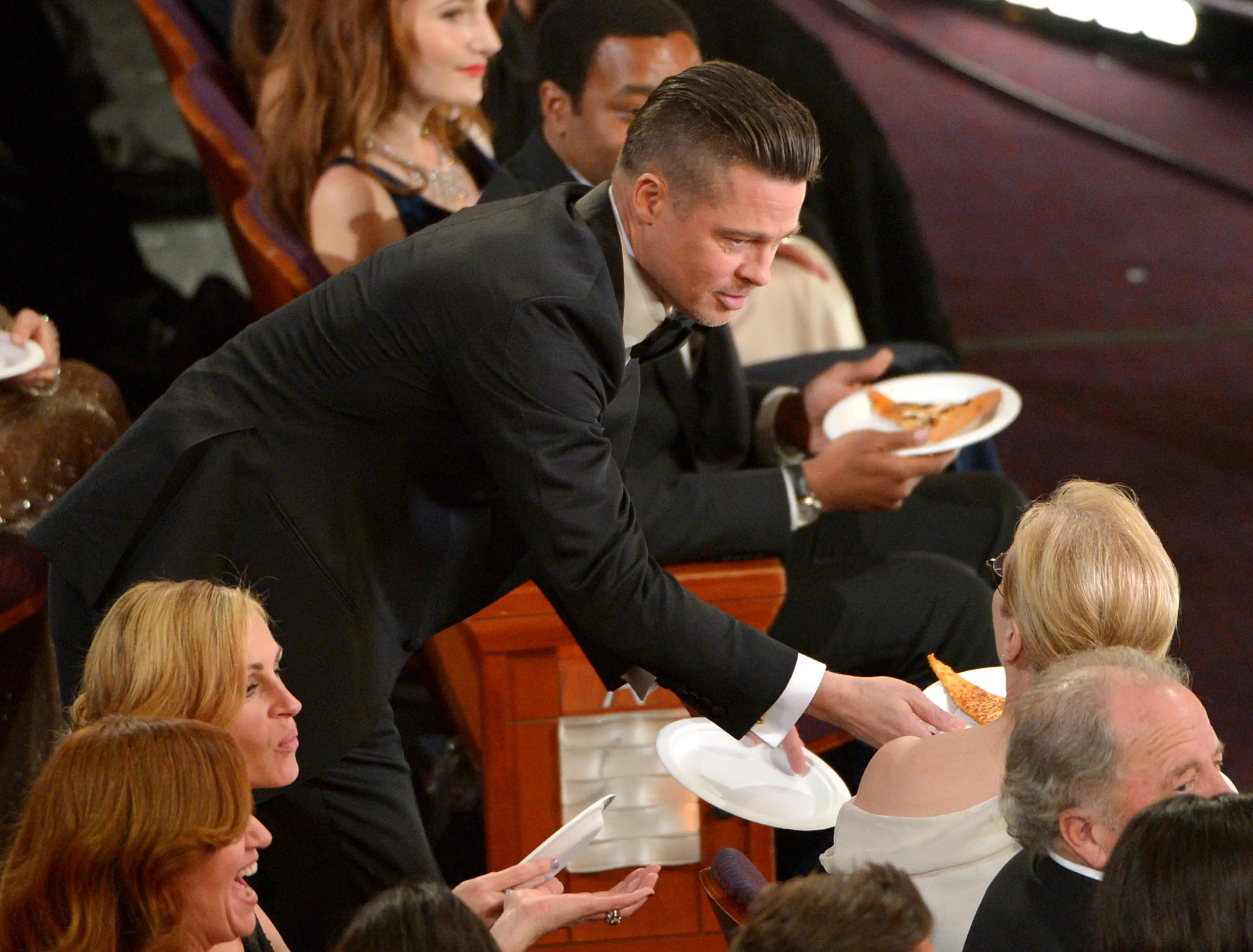 We did enjoy seeing Brad Pitt handing out pizza to everyone from Chiwetel Ejiofor to Meryl Streep, though.