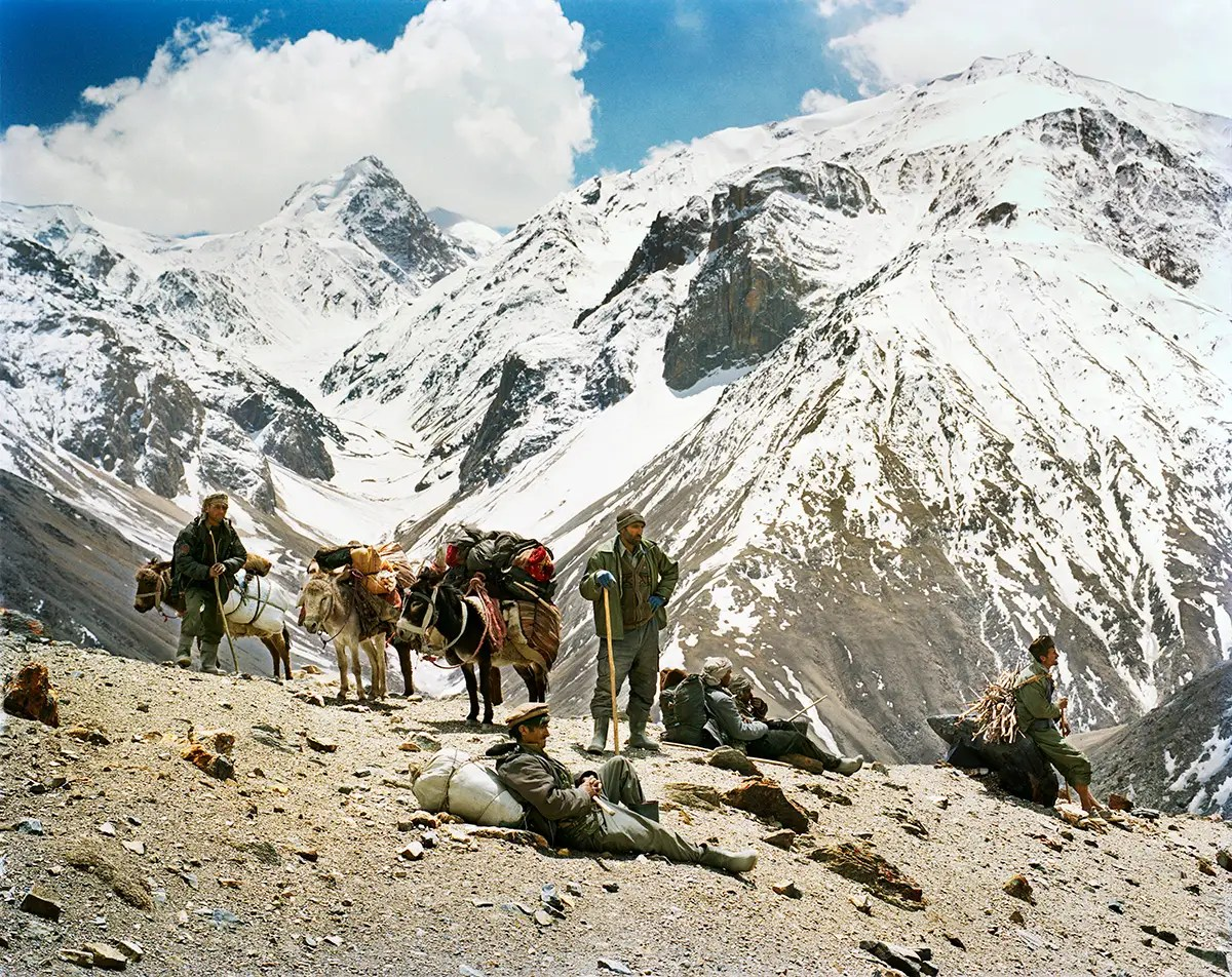 """After scaling the pass, the team took a much-deserved rest. Behind them are the Hindu Kush mountains, which Lagrange called """"mesmerizing."""""""