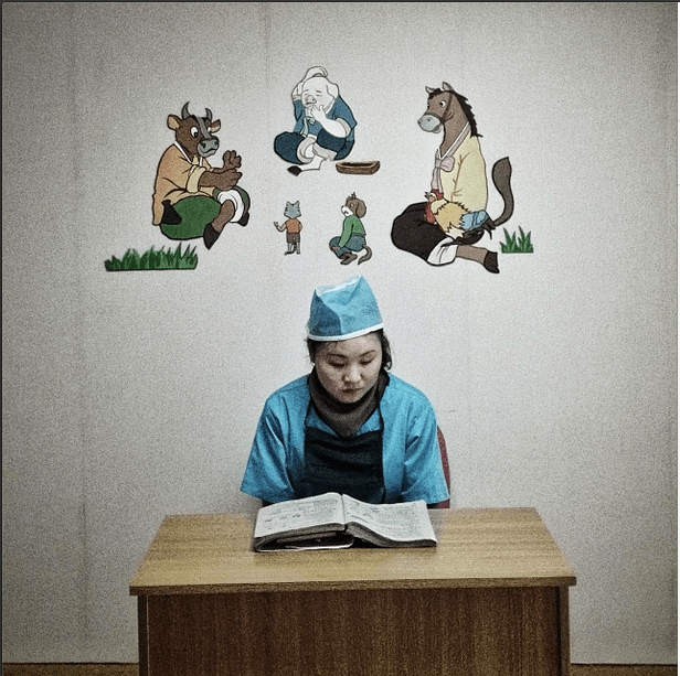 'A North Korean nurse studies in a hallway at a pediatric hospital in #Pyongyang.'