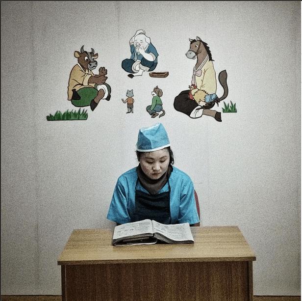 'A North Korean nurse studies in a hallway at a pediatric hospital in #Pyongyang.'