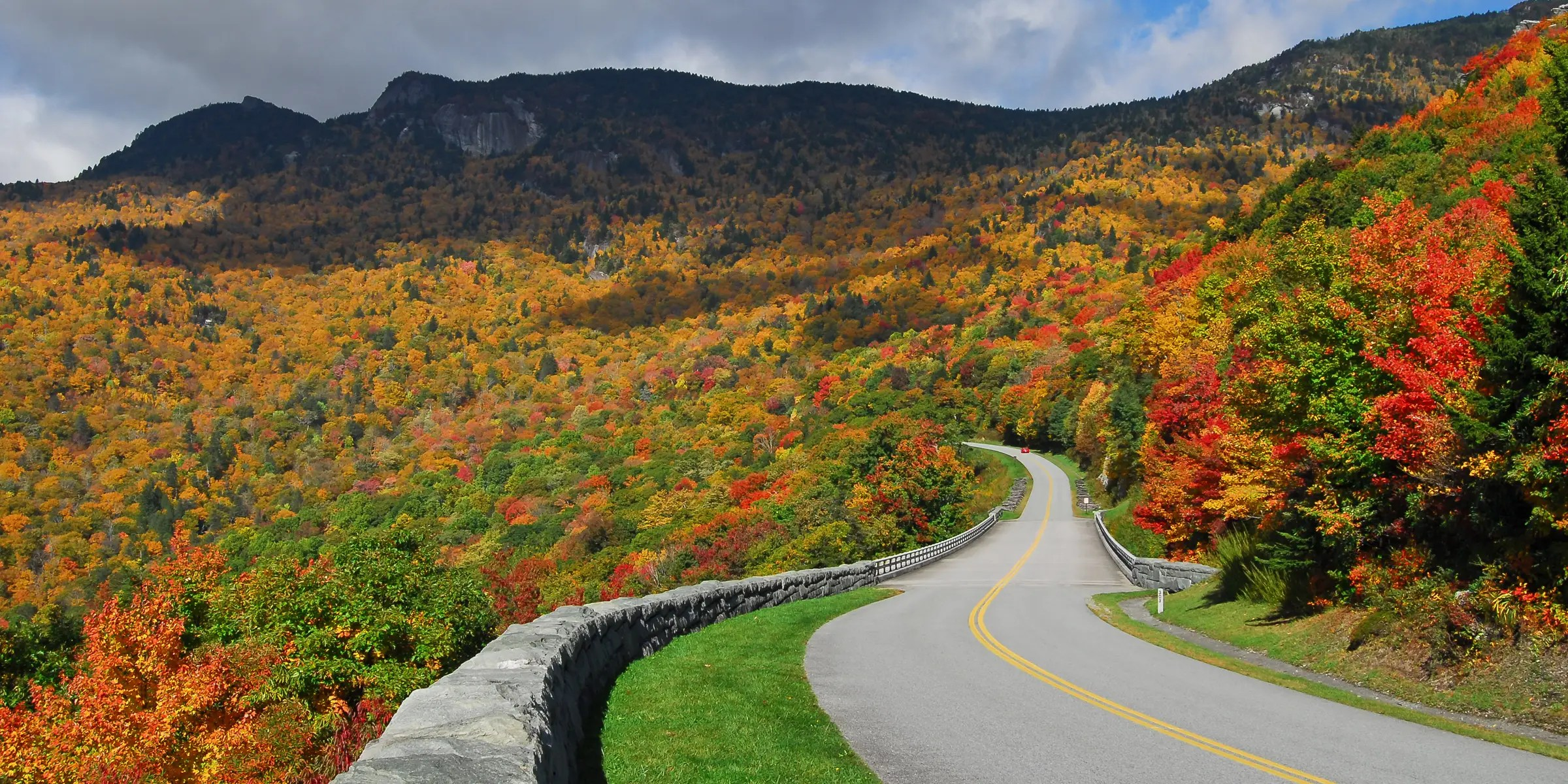 The Blue Ridge Parkway runs from North Carolina to Virginia and is known for its views of rugged mountains and the Appalachian Highlands.