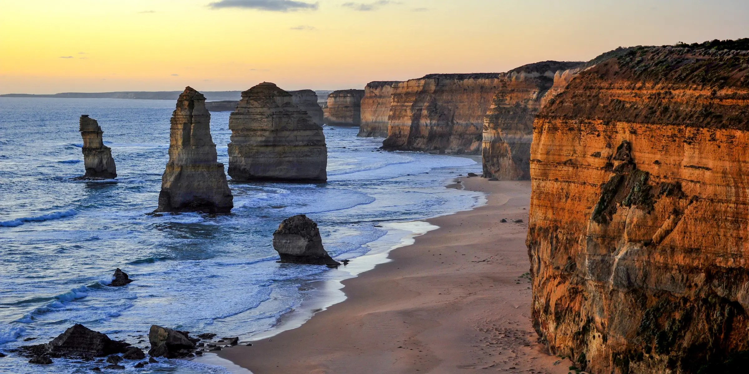 Along the beautiful Great Ocean Road in Australia, you can find the famous limestone stacks called the Twelve Apostles, whale lookouts, rain forests, and beautiful national parks.