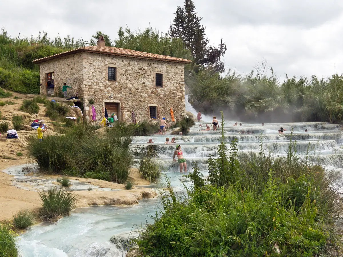 Take a dip in the natural spas of Saturnia in Tuscany, where gorgeous hot springs flow freely.