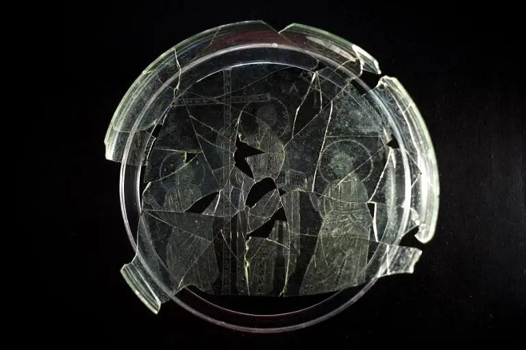 Light shines through a glass dish baring the engraved image of a Christ without a beard, sporting short hair and wearing a toga, seen at the Museum of Archaeology of Linares, in Linares, Spain, on October 7, 2014