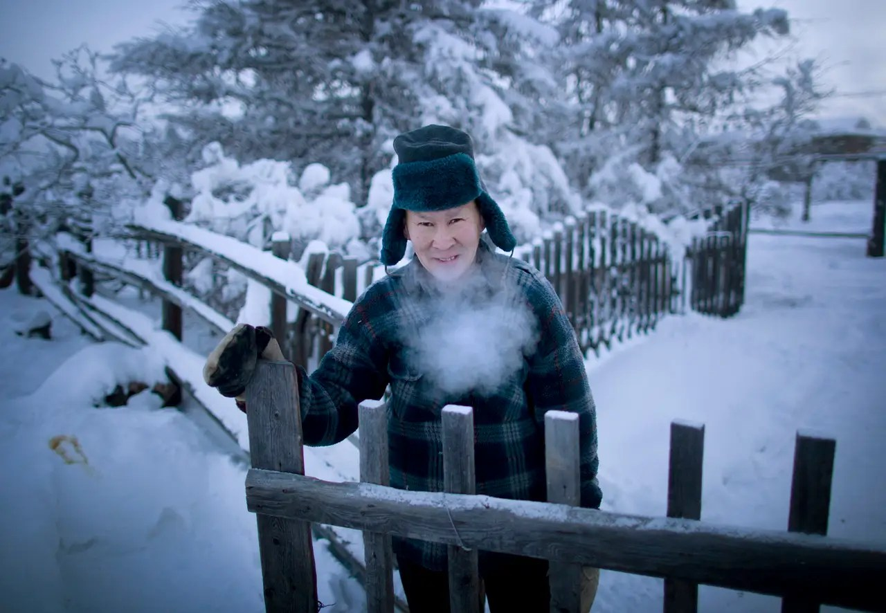 """The residents of the town identify strongly with their surroundings and history as ethnic Yakutians. Chapple says that """"life rolls on much like anywhere else, but with an eye constantly on the thermometer. Below -58 F° and things start to shut down."""""""