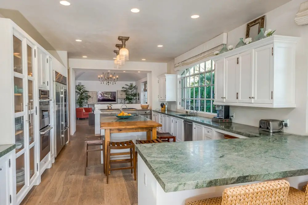 The chef's kitchen has plenty of counter space and natural light.