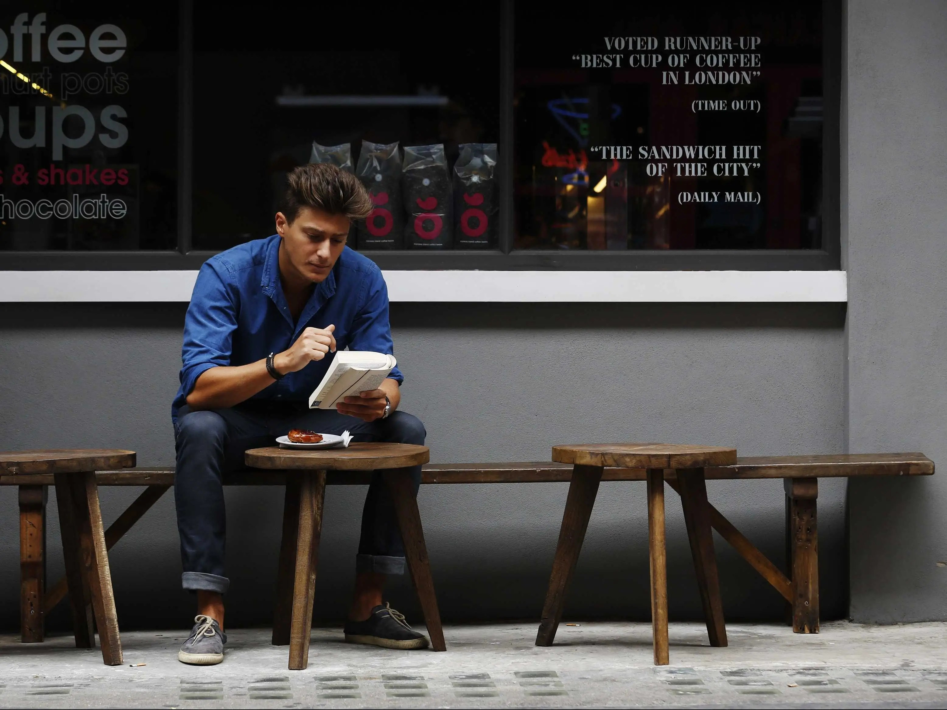 man reading book london