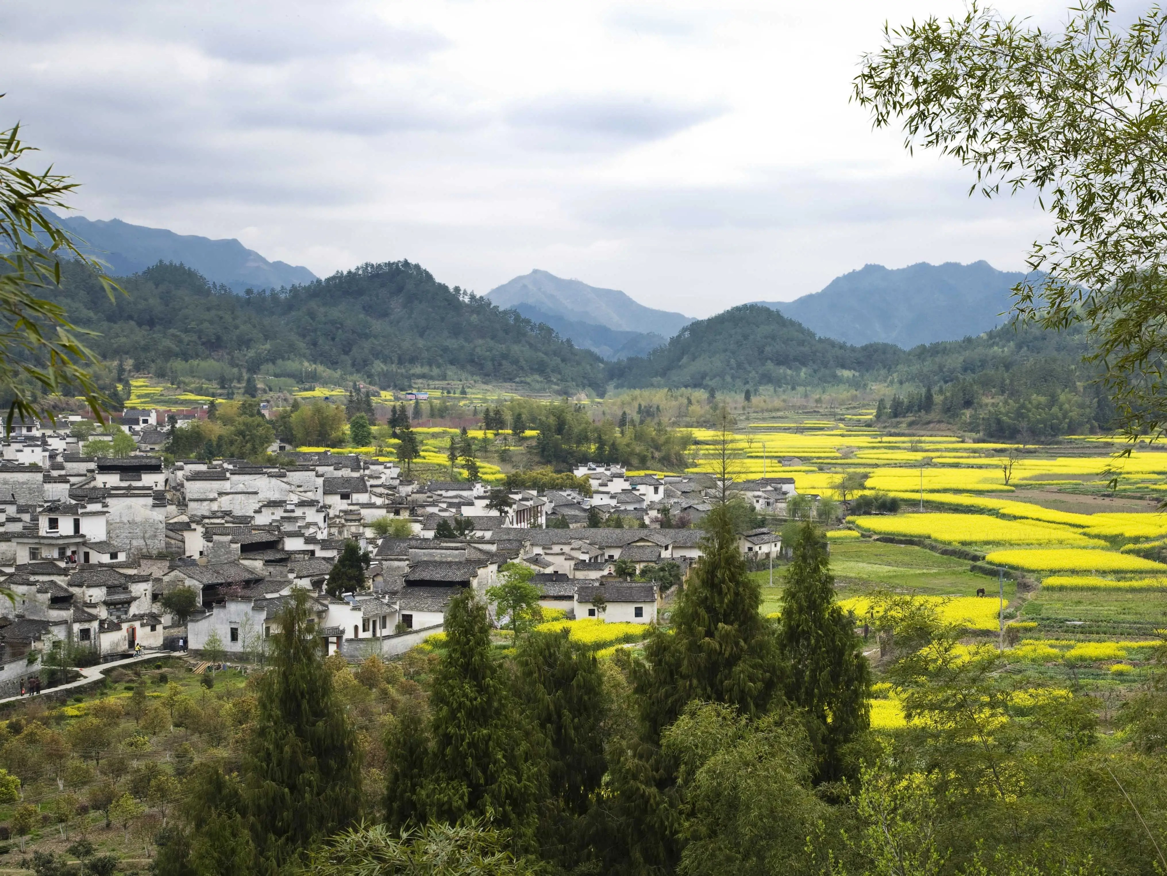 The Xidi village is located in the Yi County of the historical Guizhou region of Anhui province, China, and was declared a UNESCO World Heritage Site alongside the village of Hongcun. The village still maintains wooden residences from the Ming and Qing dynasties, many of which are open to the public.