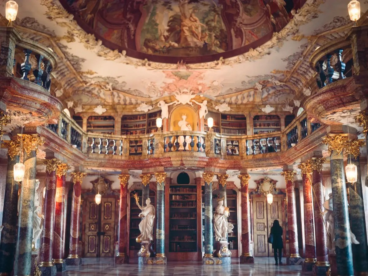 With its impressive Rococo interior, the library of the Wiblingen Monastery in Ulm, Germany, is unique and breathtaking. The upper gallery is supported by large colorful marble columns, and there are plenty of statues and frescoes to capture visitors' interest.