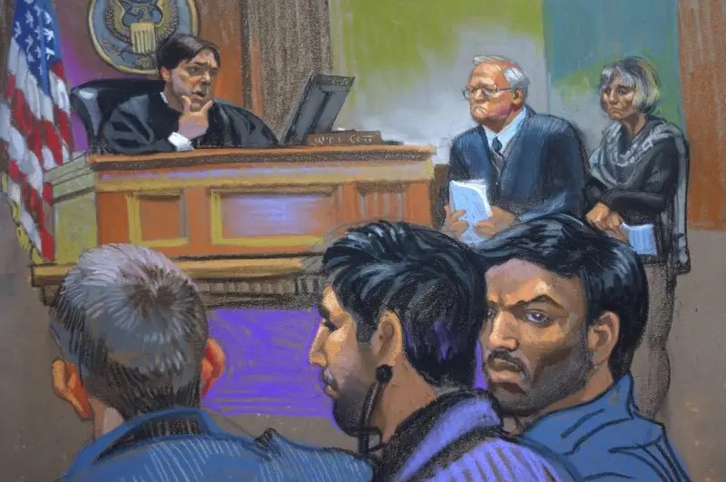 Judge James Cott (L), attorneys John J. Reilly (C) and Rebekah J. Poston (R) with defendants Efrain Antonio Campo Flores (foreground, R) and Franqui Francisco Flores de Freitas (foreground, C) during a hearing in U.S. district court in the Manhattan borough of New York in this courtroom sketch from November 12, 2015. REUTERS/Christine Cornell