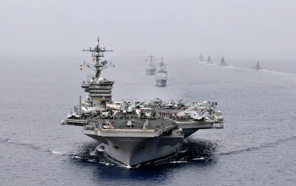 The Nimitz-class aircraft carrier USS Carl Vinson (CVN 70) leads the Ticonderoga-class guided-missile cruiser USS Bunker Hill (CG 52) and the Arleigh Burke-class guided-missile destroyer USS Halsey (DDG 97) during a passing exercise with Indian navy ships during Exercise Malabar 2012.