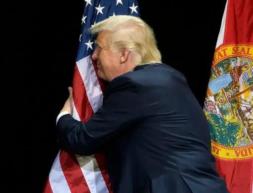Image result for TRUMP HUG FLAG GIF
