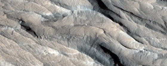 Yardangs, which are sharp ridges scraped away by Mars' harsh winds.