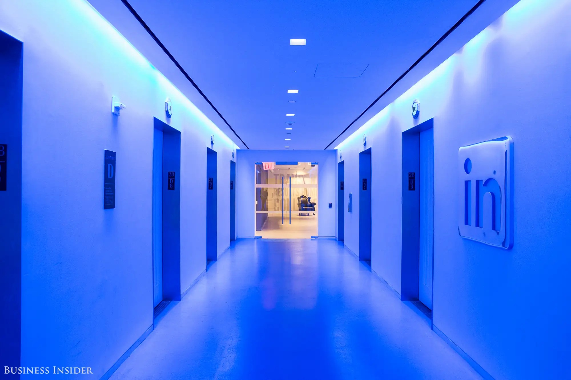 """Next, we visited the 28th floor. The elevator doors opened to a bright blue, almost futuristic central lobby. It was one of the most striking locations of all. """"We wanted people to feel like they're arriving at a destination,"""" Campofelice says."""