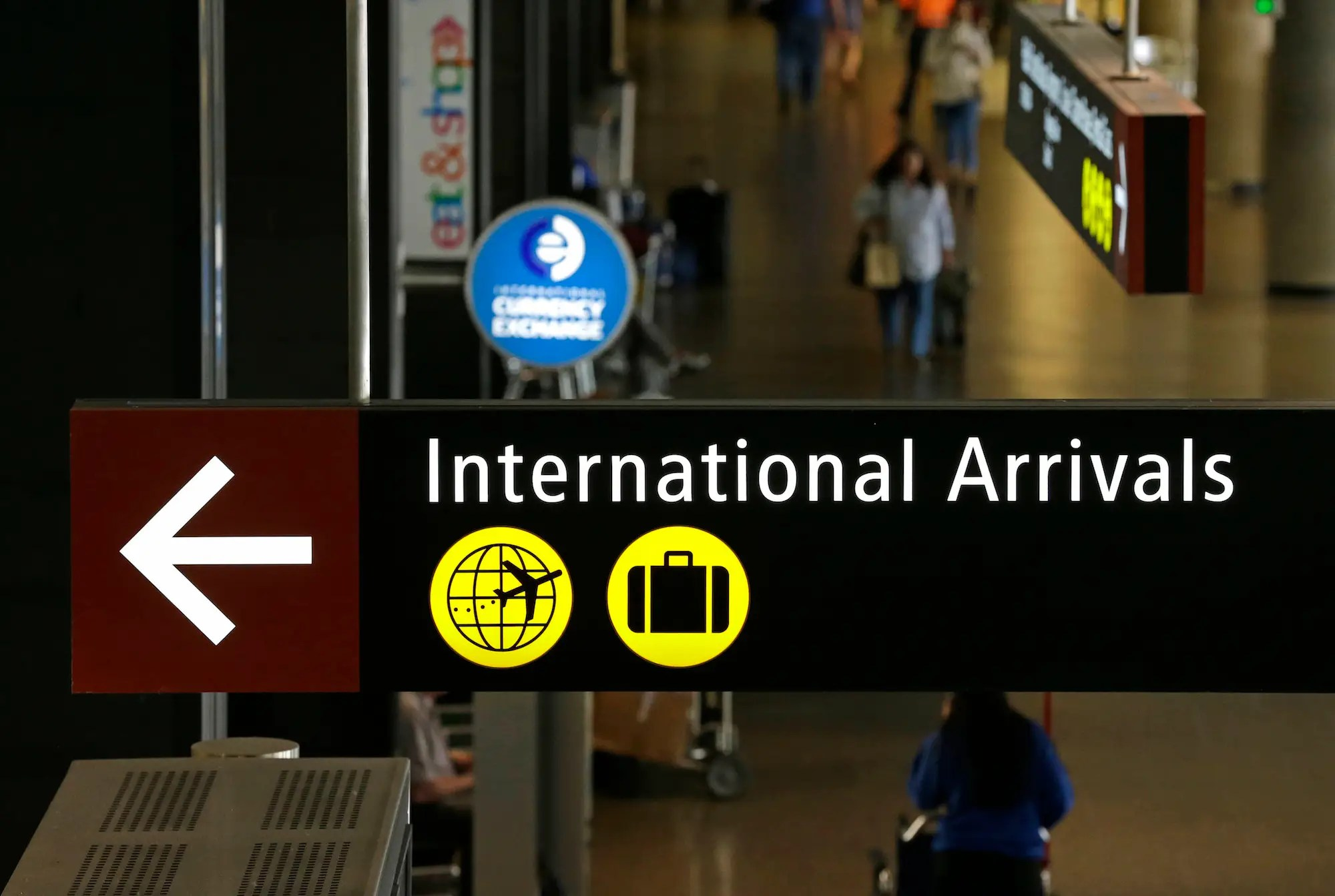 international arrivals airport trump travel ban